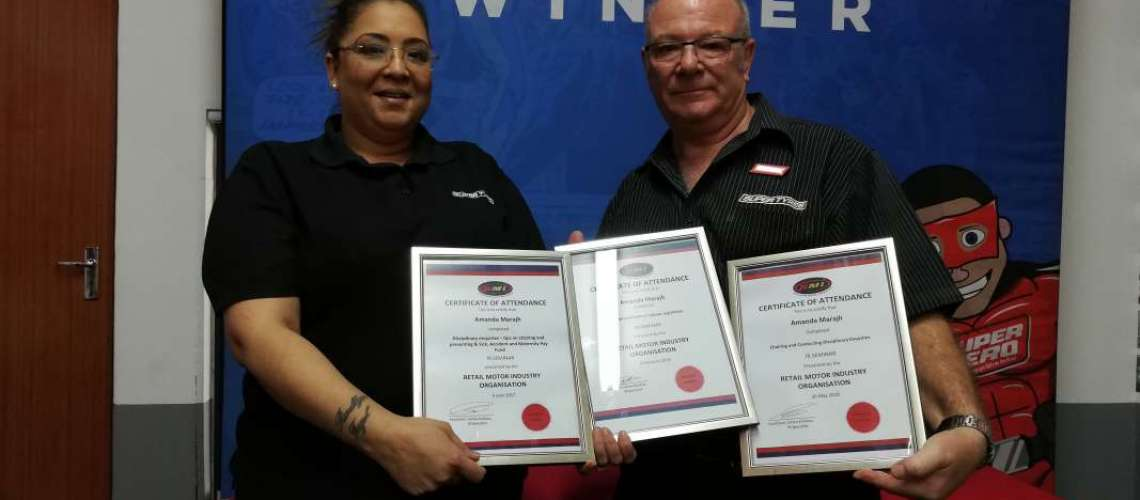 Amanda receives her certificates from General Manager Graham Bush.